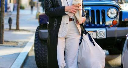Katie Holmes Memadukan Setelan Khaki dengan Jaket Trench untuk Tamasya di New York