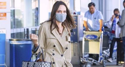 Angelina Jolie Kembali Pamer Airport Style Memesona yang Terdiri dari Dior Trench Coat dan Celine Tote Bag