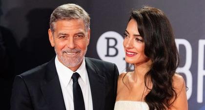 George Clooney Menyelamatkan Amal Clooney yang Tersandung di Red Carpet